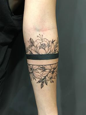 flower band blackwork tattoo
