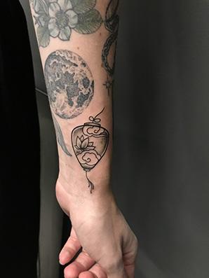 blackwork lantern tattoo